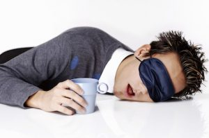 exhausted-man-sleeping-with-head-on-desk