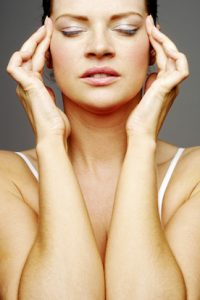 stresse-woman-massaging-her-head